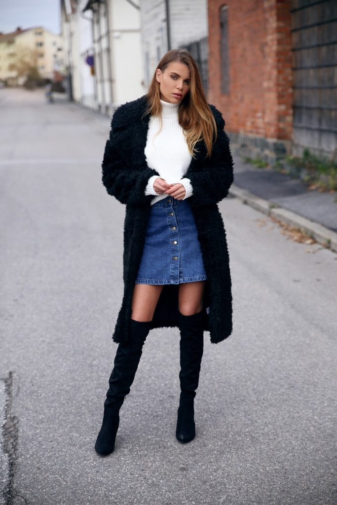 Josefin Ekström wears a cute denim button front skirt with her over the knee boots.  Coat: Bubbleroom, Boots: Putfeetfirst.com, Sweater: Junkyard, Skirt: Bikbok.