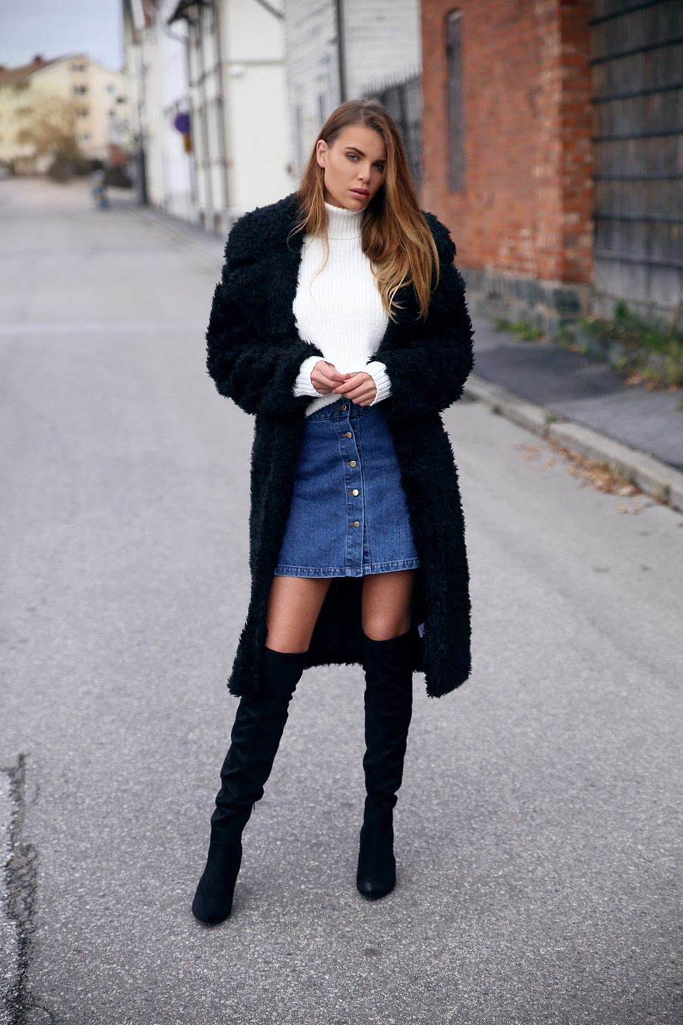 6b841bd2f1 Josefin Ekström wears a cute denim button front skirt with her over the knee  boots.