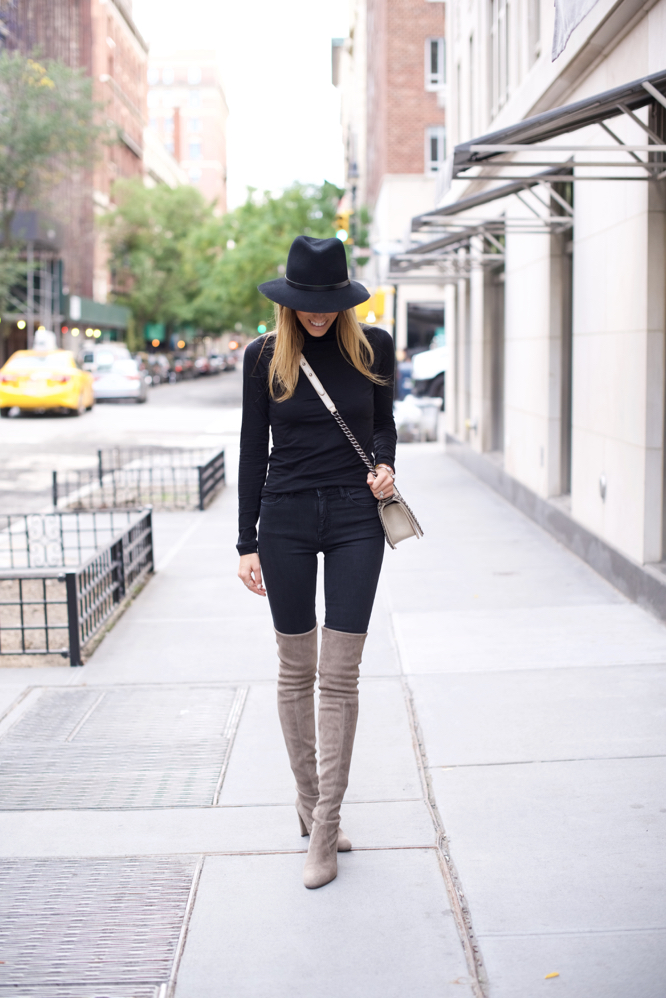 5150448040c Neutral coloured over the knee boots will look great paired with an all  black outfit.