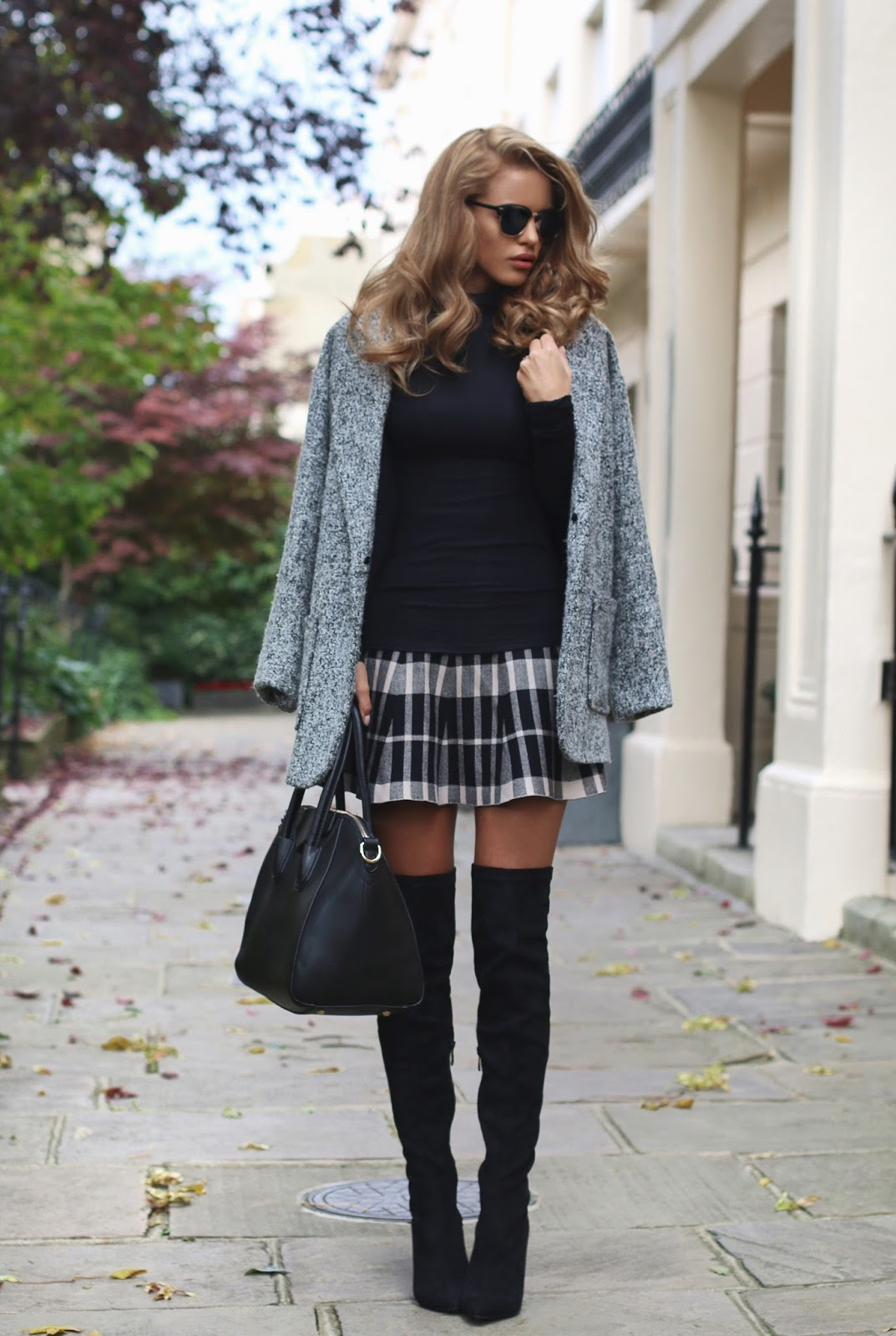 9cf674313f5e Nada Adelle wears patent over the knee boots with a cute tartan mini skirt  and a