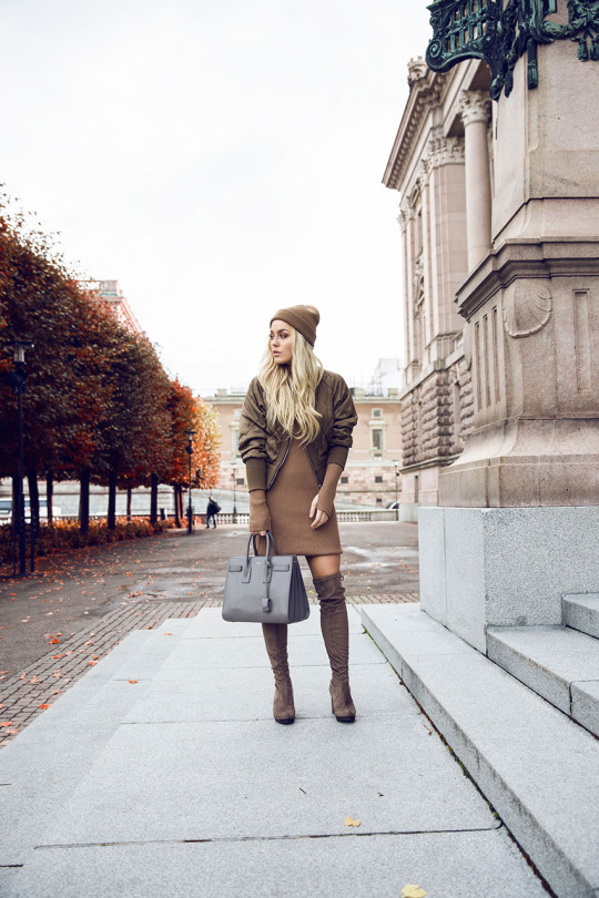 Angelica Blick rocks the neutral trend in these nude over the knee boots, worn with a mini dress and bomber jacket.   Dress: Gina Tricot, Hat: Topshop, Boots: ASOS, Bag: Yves Saint Laurent.