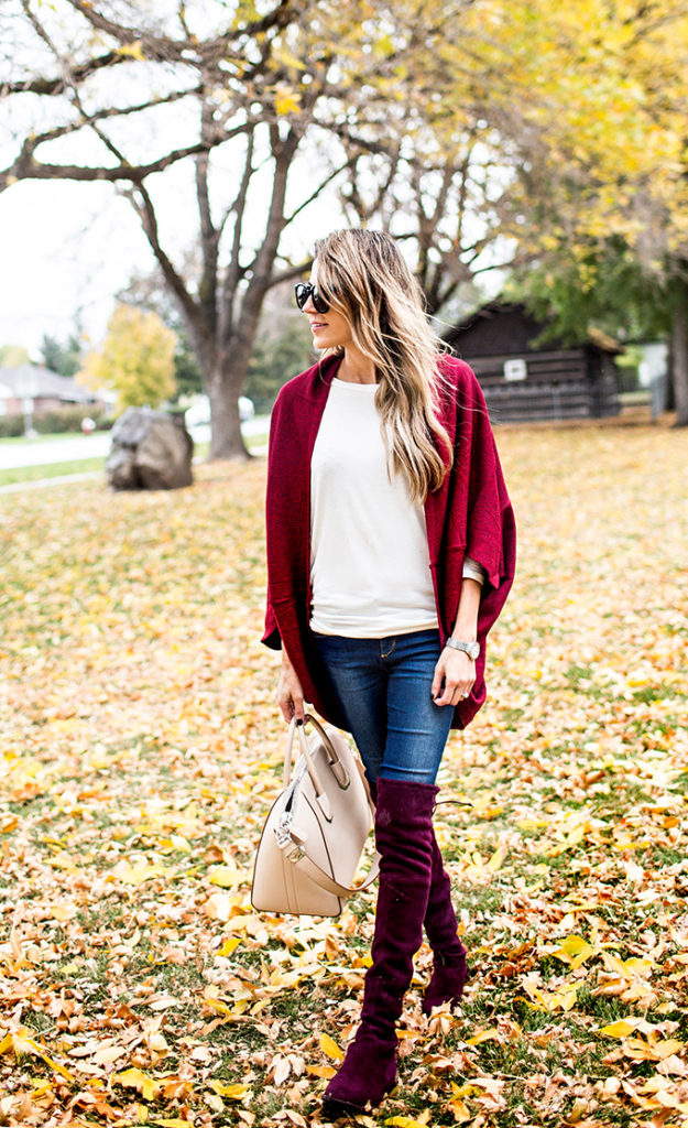 Christine Andrew wears a gorgeous pair of velvet over the knee boots with skinny denim jeans and a crimson shrug.   Shrug: Ily Couture, Boots: Stuart Weitzmann.