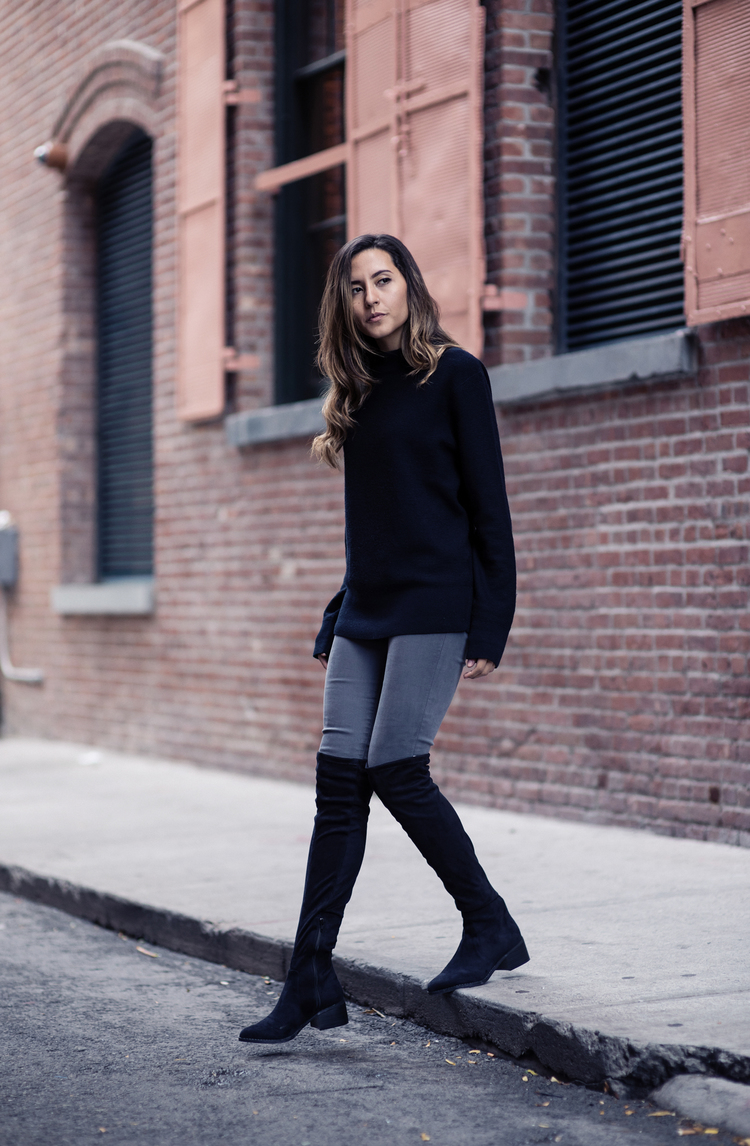 51a28508d5e Raquel Paiva wears a pair of over the knee boots with a simplistic black  knit sweater
