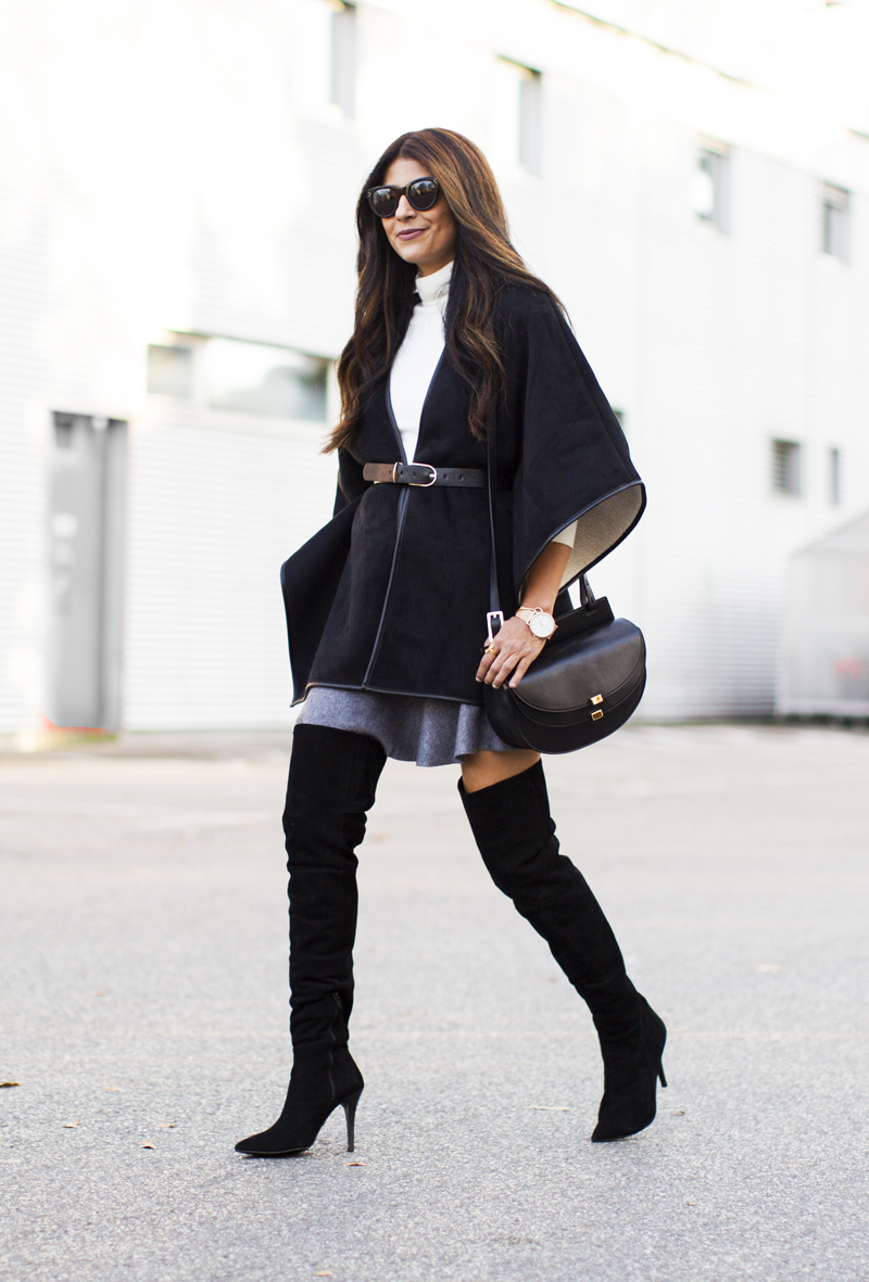A cape coat will look fabulous worn with over the knee boots and a simple turtleneck, as demoed here by Laura Dittrich. Overknee Boots/Cape: Buffalo, Skirt/Turtleneck: Zara.