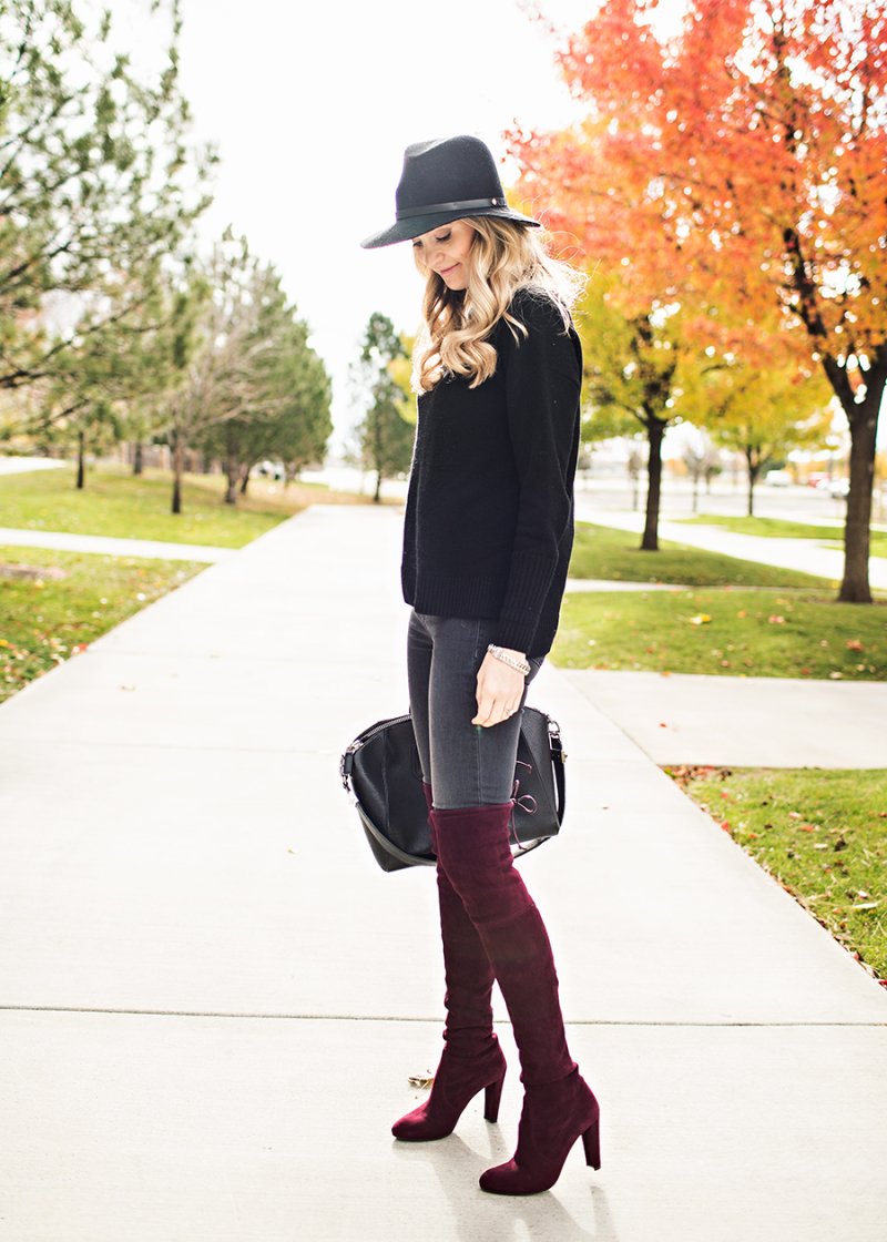 Coloured boots can make a great addition to a simple jumper and jeans outfit. Emily Jackson wears a crimson velvet pair from Stuart Weitzman. Sweater: J.Crew, Jeans: Rag and Bone, Boots: Stuart Weitzman, Hat: Rag and Bone, Bag: Givenchy.