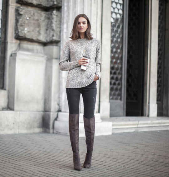 Nika Huk looks ultra sophisticated in this casual chic outfit consisting of a grey knit sweater, skinny grey jeans, and leather over the knee boots. We love the simplicity of this look. Sweater: Topshop, Jeans: Asos, Boots: Lamoda, Necklace: Jane Kønig.