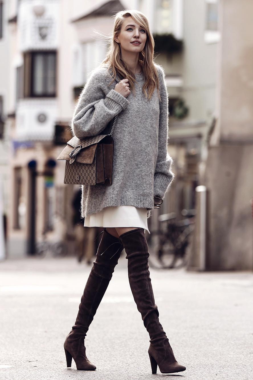 e1d39c4504 Try wearing an oversized knit sweater with a pale or pastel coloured skirt  and overknee boots