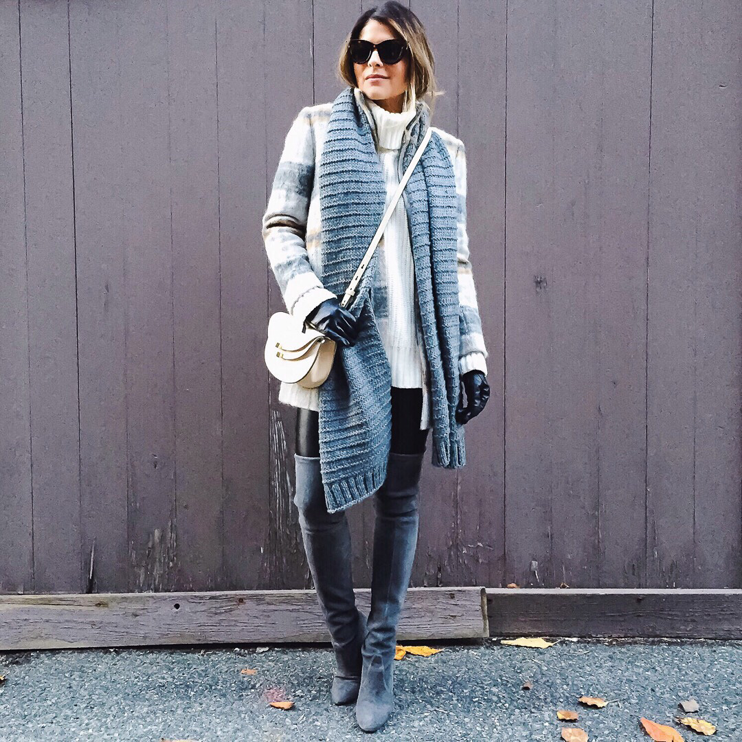 Wear over the knee boots with oversized knitwear to get a really festive look which will also keep you toasty warm through the winter season. Pam Hetlinger wears the look with a chunky knit scarf and cross body bag. Boots: Stuart Weitzman.