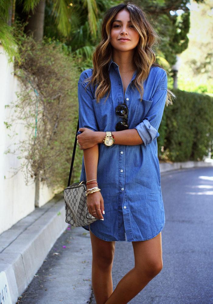 Julie Sarinana is wearing casual denim shirt dress with trendy clutch bag. Denim shirt dress: Everlane, Sandals: Everlane, Bag: Vintage Gucci.