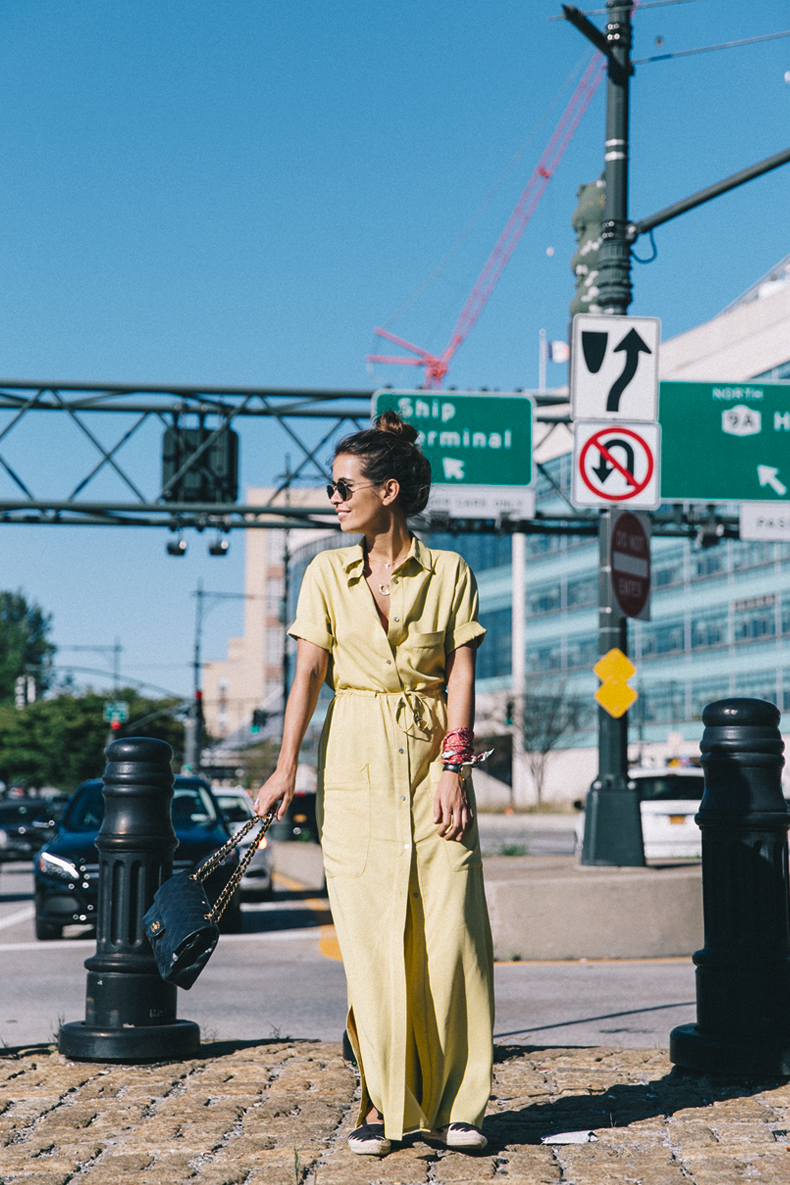 Sara Escudero is a vision of summer beauty in this bright yellow maxi shirt dress from Asos! Pair a similar piece with espadrilles and a leather bag to steal Sara's summer style. Dress: ASOS, Shoes: Castañer, Bag: Chanel Vintage, Scarf: Purificación.