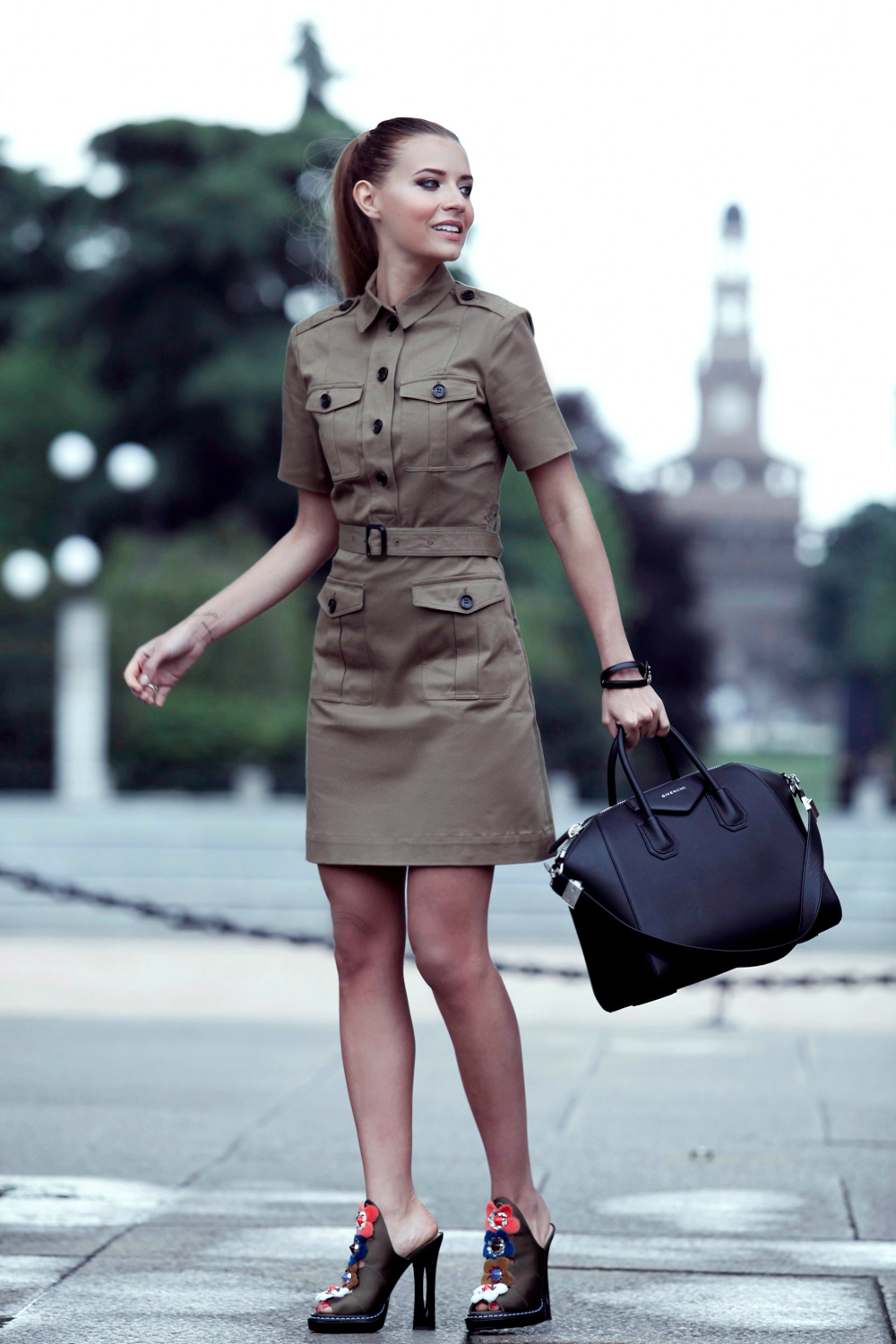 A military style shirt dress is a must have this summer! Veronica Ferraro looks ready to take on the world in this super cute khaki piece, and we the femininity which is added to the look through these gorgeous embroidered floral heels! Dress: Burberry, Bag: Givenchy, Shoes: Fendi.