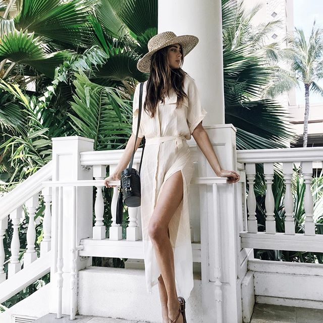 A maxi shirt dress is a must have this summer! This dress worn by Kelsey Taylor White has combined sophistication and sex appeal through simple but revealing slit detailing at the thigh. We absolutely love this look! Brands not specified.