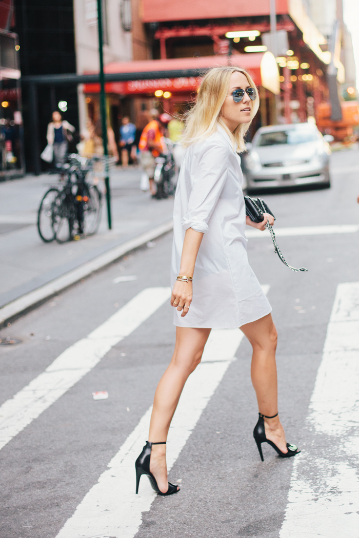 This simple white shirt dress can be glammed up with a pair of black stilettos. Via Jacey Duprie. Dress; Acne Studios, Heels; Pierre Hardy