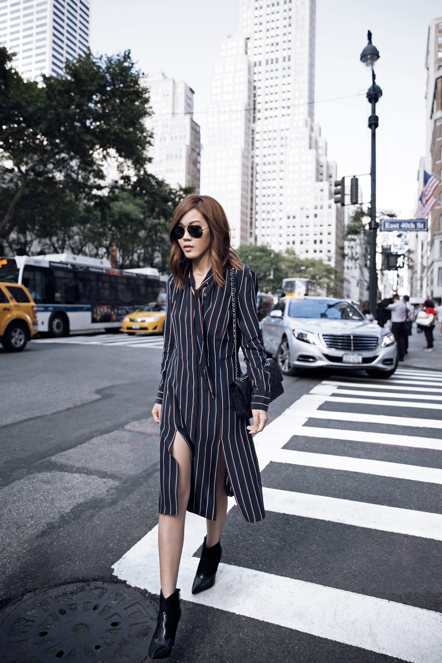 This striped shirt dress looks effortlessly cool with simple black heels and shades. Via Jenny Tsang. Dress: Frame Denim.