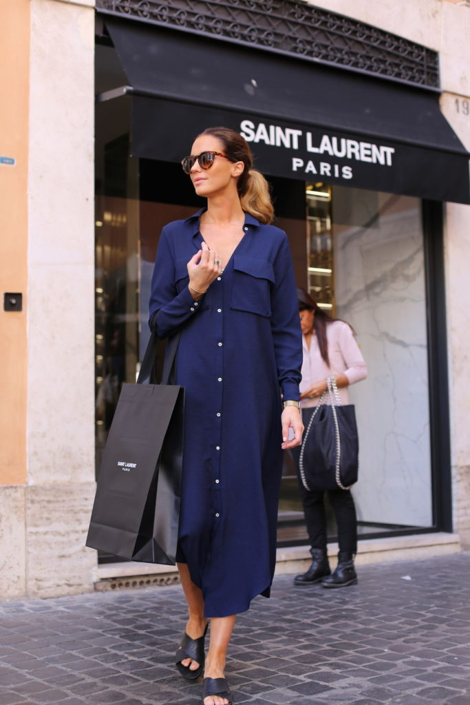 This long navy shirt dress looks great on Annette Haga. Try wearing something similar with sandals for a simple but stylish look.   Brands Not Specified.