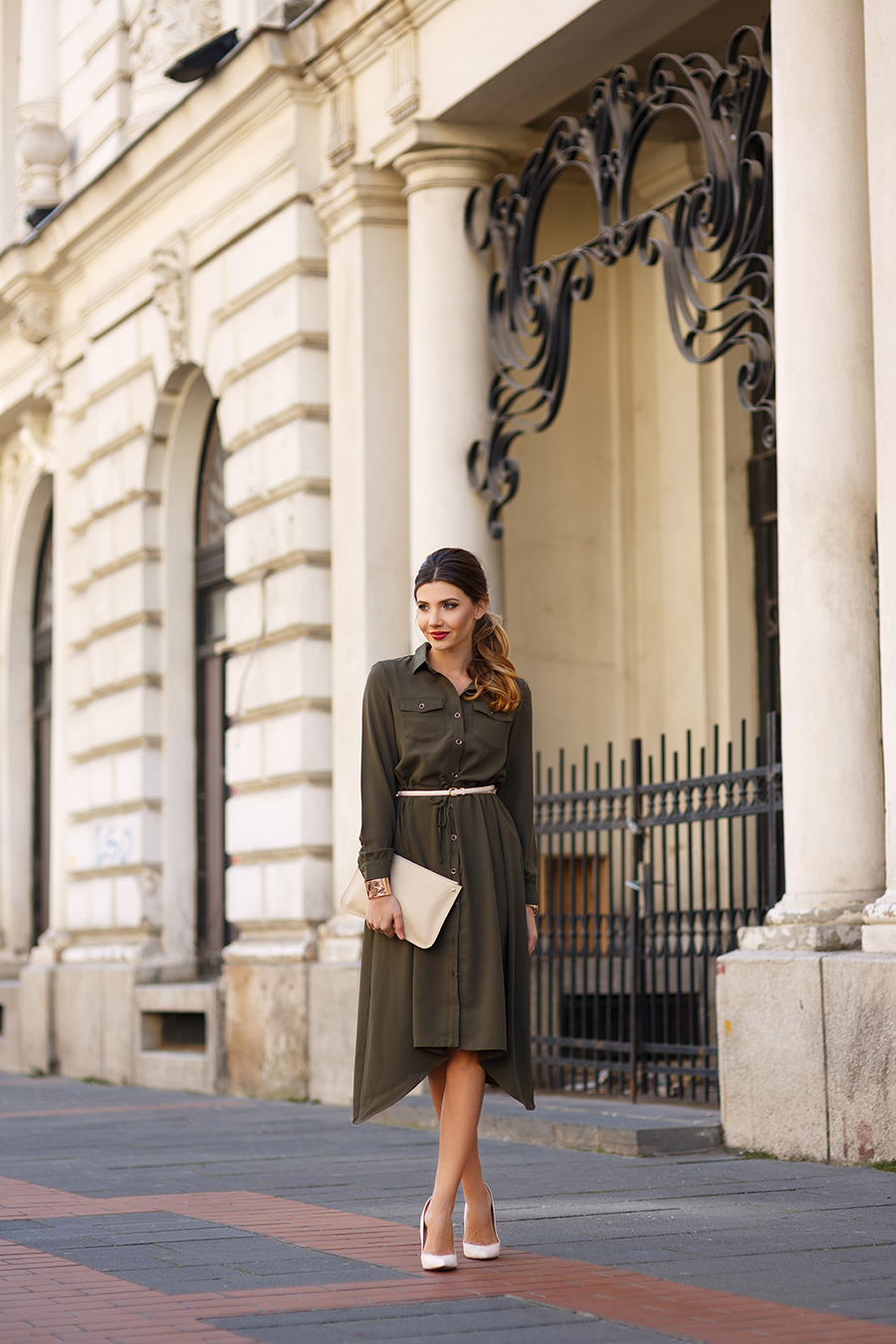 Smarten up a classic khaki shirt dress by adding a skinny belt and matching heels. Not only will this accentuate your waistline, but will also add some individuality to your look. Via Larisa Costea. Dress: Chicwish, Stilettos: Little Mistress, Clutch: Corto Moltedo.