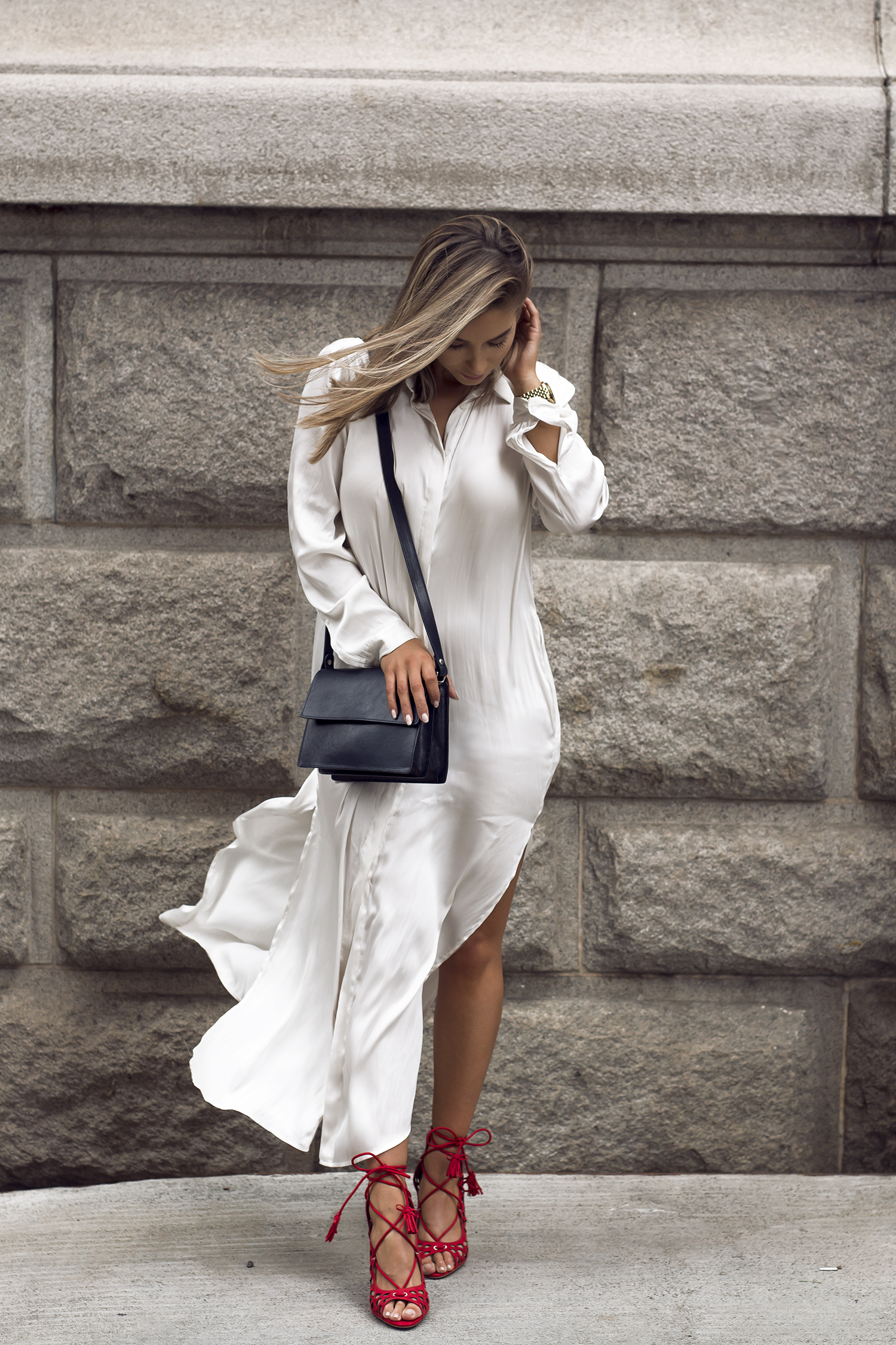 Whoever said the shirt dress wasn't glamorous was absolutely wrong! Take style inspiration from Emilie Tømmerberg, who is looking ravishing in a silk shirt dress with slit detailing for that sexiness we all crave! Dress: H&M, Shoes: Zara