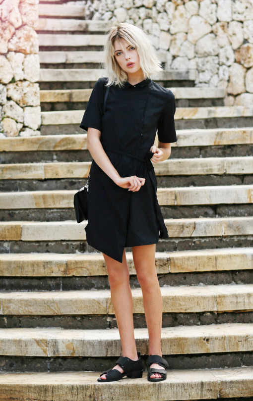 This cute and simple black shirt dress is gorgeous paired with chunky sandals and a cross body handbag. Wear this style in all black to steal Ebba Zingmark's striking aesthetic. Dress/Bag: Monki, Shoes: Sarenza.