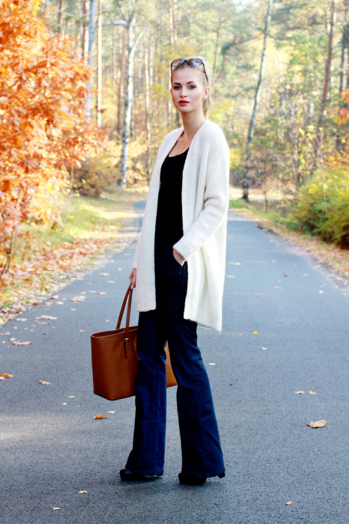 Paula Jagodzińska wears an authentic pair of denim flares with a gorgeous white cardigan from   Cardgian: Diverse, Top: Zara.