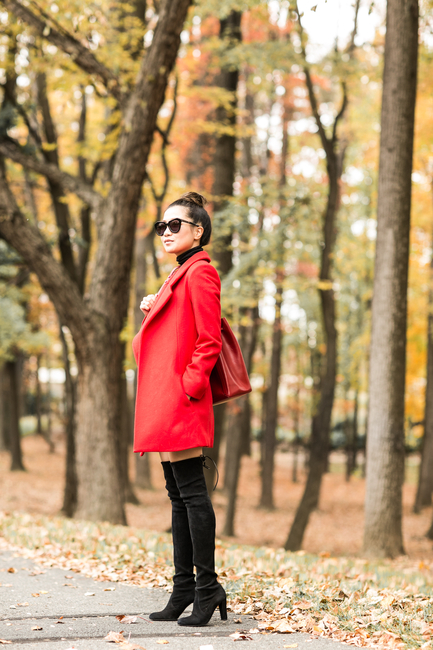 Over the knee boots are a must this fall. Wendy Nguyen wears a pair with a statement red coat and shades.   Jacket: Nicholas, Dress: Topshop, Shoes: Stuart Weitzman, Bag: Loeffler Randall.