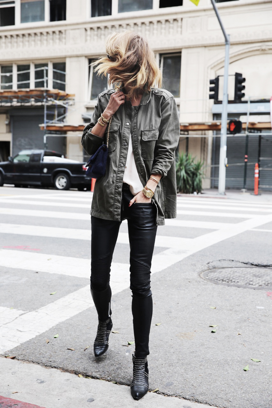 Anine Bing exudes tomboy vibes in a khaki jacket and studded boots. Outfit: Anine Bing (Brand).