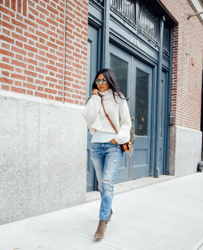 2411a45819 Sheryl Luke looks cute and casual in a knitted cream sweater and classic  ripped jeans.