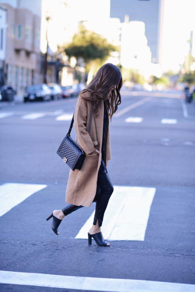 Camel coats are totally in this season. Paola Alberdi wears this coat with leather leggings and a pair of black heels.   Coat: Few Moda, Dress: Fifteen Twenty Dress, Leggings: LXE.
