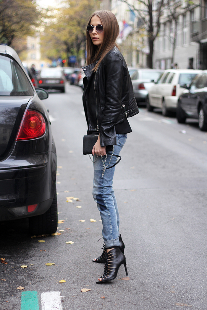 6b0ba91f1b9 Style up a classic leather jacket and jeans outfit by adding funky heels  like this gladiator