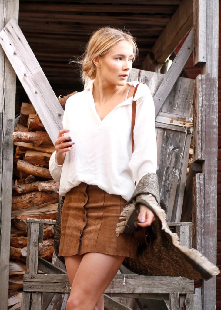 Petra Karlsson wears a white blouse with her pleated leather button front skirt.  Skirt: Shein.