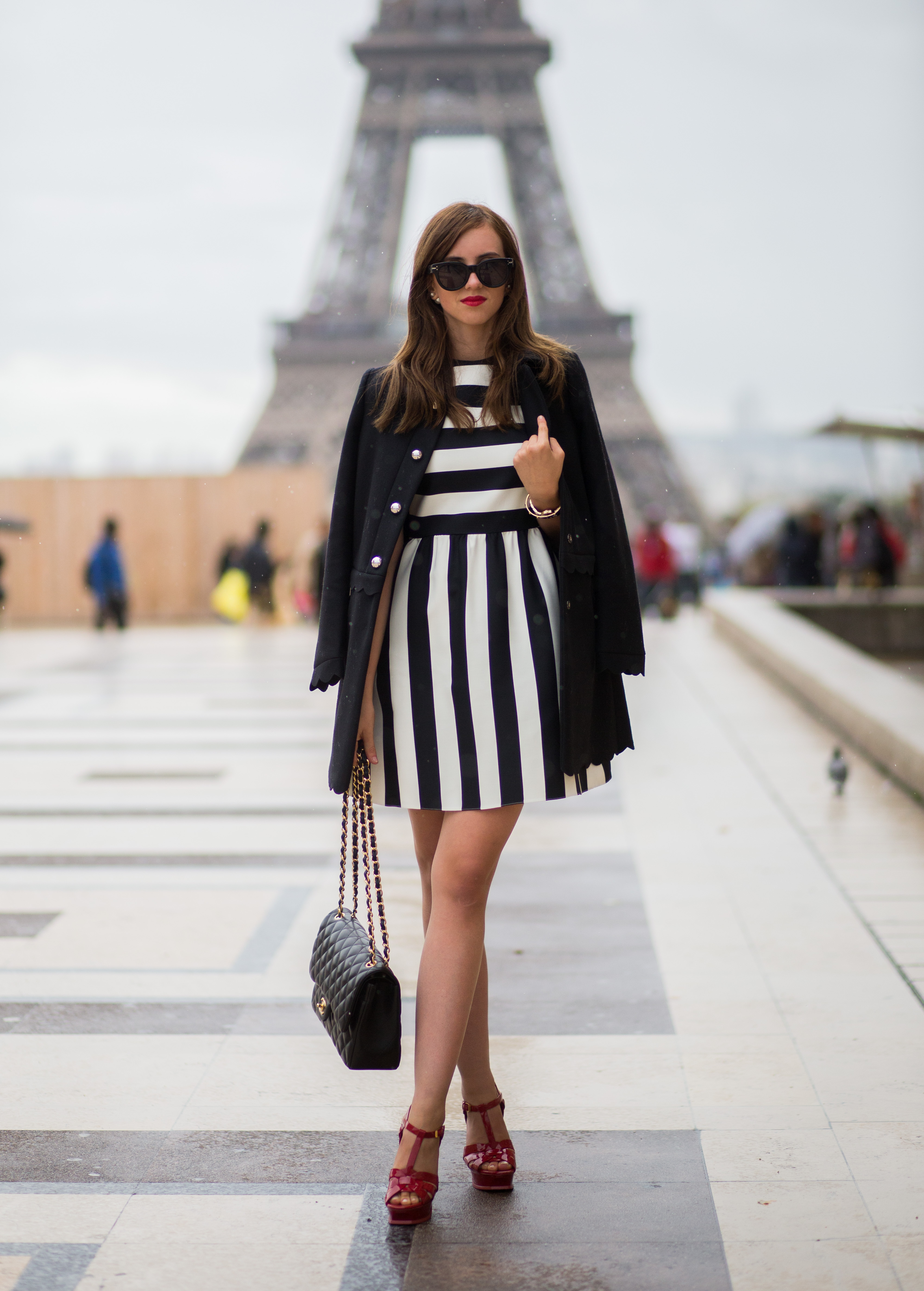 Barbora Ondrackova rocks the vertical stripe trend in this statement mini dress. Dress: Valentino, Heels: Saint Laurent.