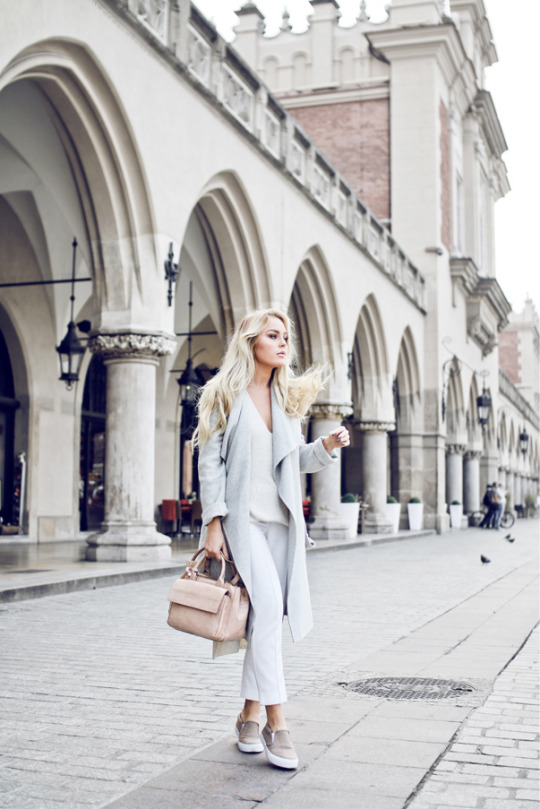 Angelica Blick is a picture in marl grey, wearing a long knit coat over pastel cigarette trousers.   Bag/Coat/Top: Zara, Trousers: Topshop, Shoes: ASOS.