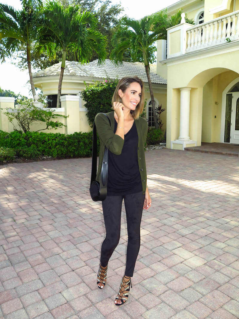 Louise Roe keeps it simple in a green cardigan, a black tee and leggings. Trousers/Tee:Joe Fresh, Heels: Paul Andrew, Cardigan: Joe Fresh.