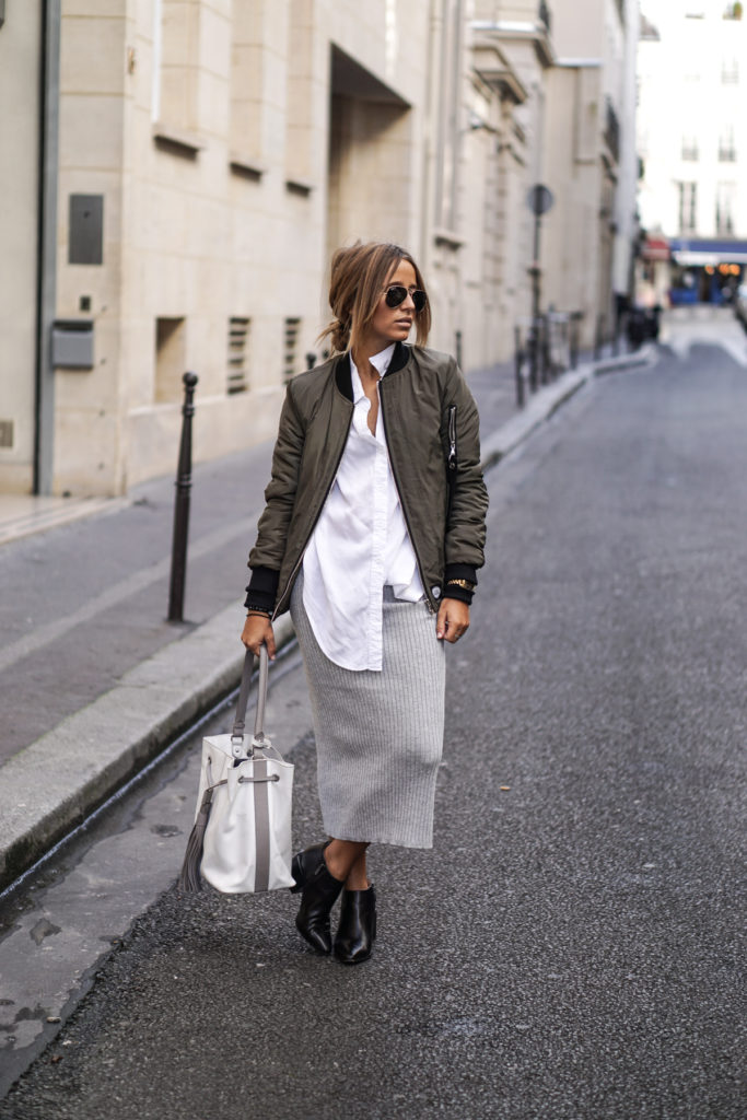 Camille Callen wears a grey jersey skirt with cute ankle boots and a khaki bomber jacket.   Jacket: Sixth June, Shirt: Sheinside, Skirt: Forever21, Boots/Bag: Clarks.