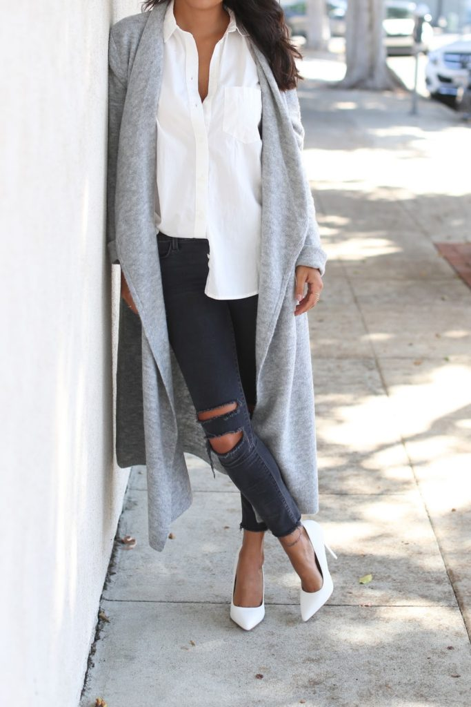 A simple white blouse looks great paired with ripped skinny jeans and a long cardigan. Via Ashley Torres.   Cardigan: BB Dakota, Blouse: Madewell, Jeans: J Brand, Heels: Kardashian Kollection.
