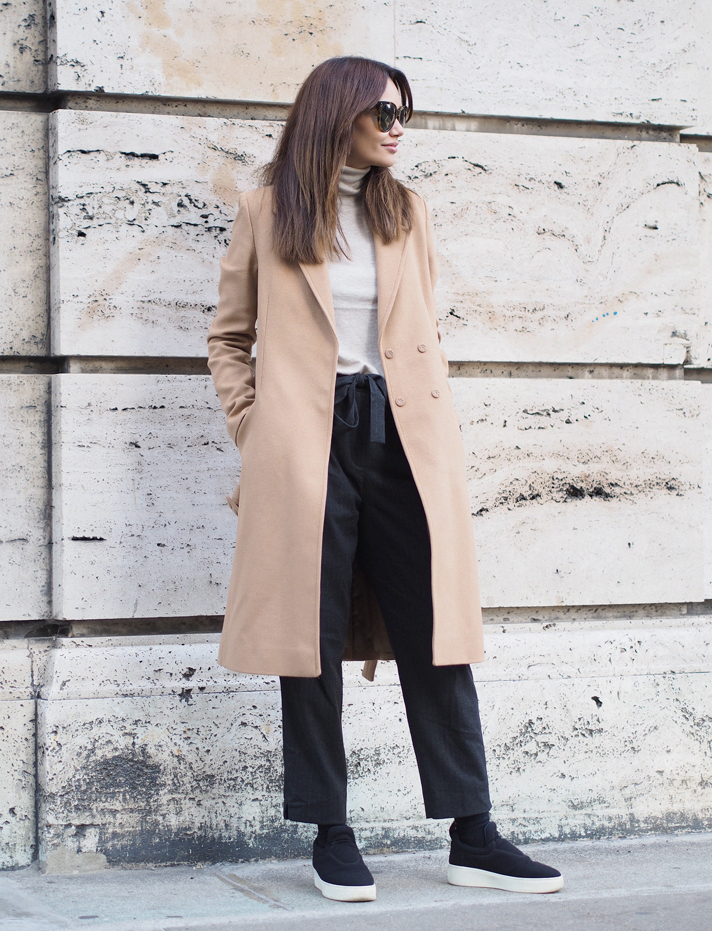 Funda Christophersen looks cool and sophisticated in cropped black trousers and a cute white turtleneck top. Coat: Designers Remix, Top: Second Female, Trousers: Zara.