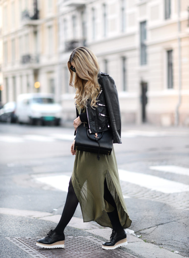 Annette Haga wears a floaty khaki dress over black tights and chunky flats.   Top/Dress/Shoes: Sheinside.