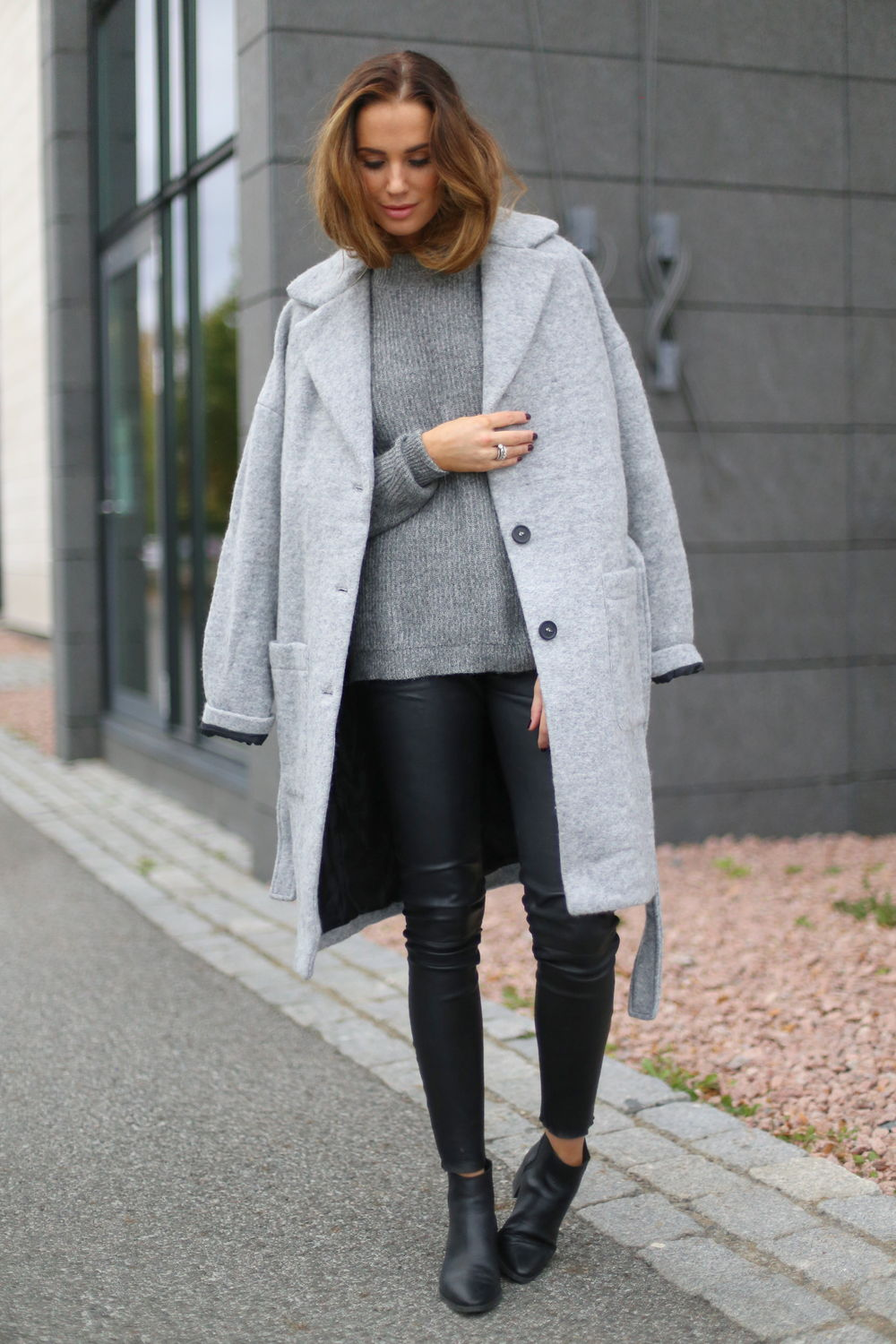 6c8a8ef4301 Casual Fall Outfits. Benedichte pairs leather trousers with a grey knit  pullover and a matching boyfriend coat. Jacket