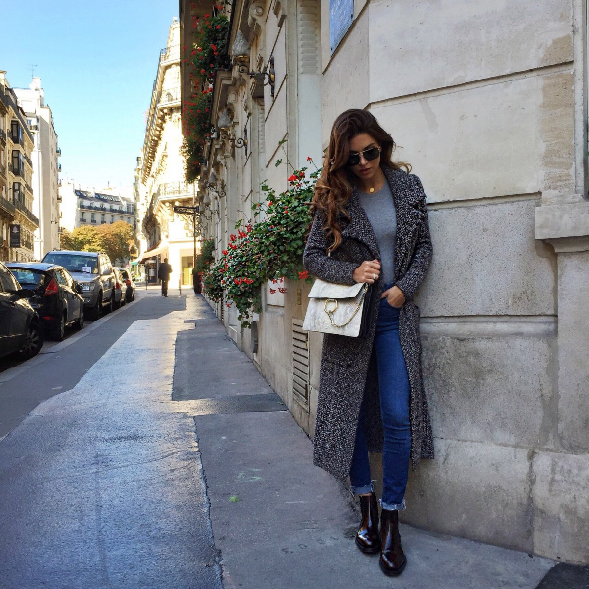 Negin Mirsalehi accessorises a long coat and jeans with a cute panel bag by Chloé Faye. Jacket: Zara, Jeans: Topshop, Shoes: Prada.
