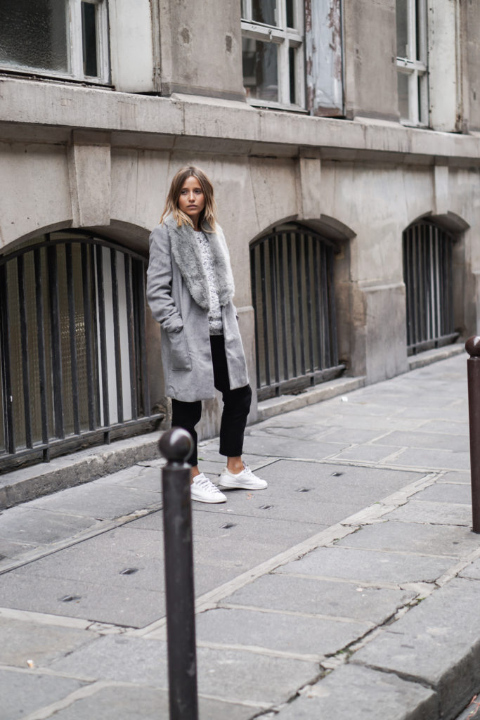 A fur trimmed coat looks great paired with simple black cigarette trousers and a knitted sweater. Via Camille Callen.  Coat/Jumper: Jennyfer, Boots/Trousers: ASOS.