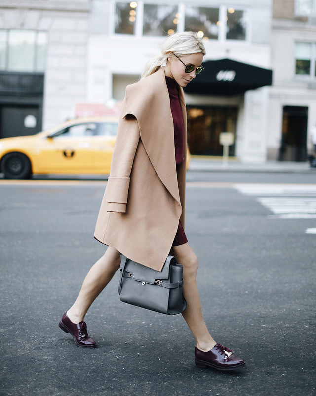 Mary Seng wears burgundy and camel; the perfect colour transition into winter. Jacket: Vince, Sweater/Skirt/Brogues: French Connection, Bag: Henri Bendel.