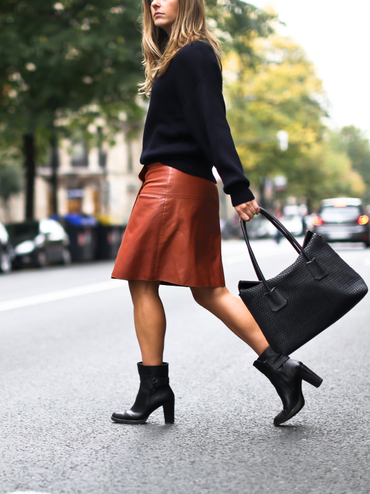 Izortze Setien wears a cute red leather skirt and a pair of heeled ankle boots. Knit: Zara, Skirt: Filippa K.