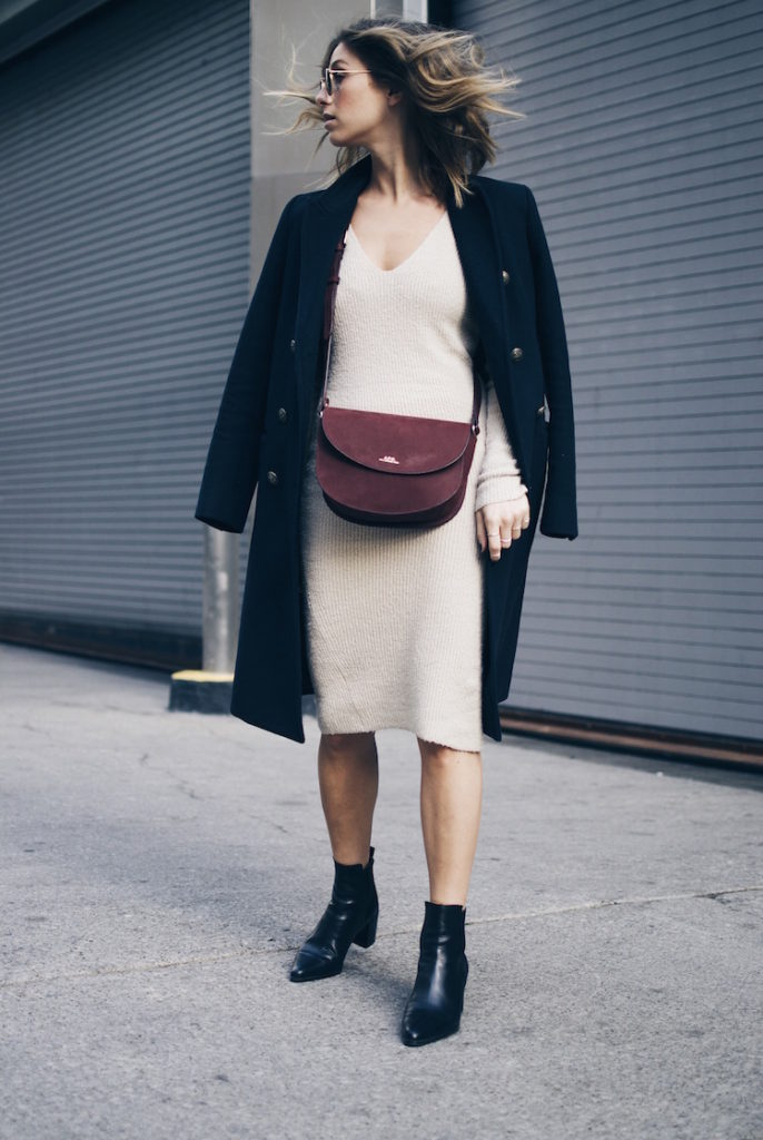 Try wearing a sweater dress with ankle boots and an oversized coat this fall. Via Jill Lansky.  Dress/Coat: Aritzia, Boots: Zara, Bag: A.P.C.