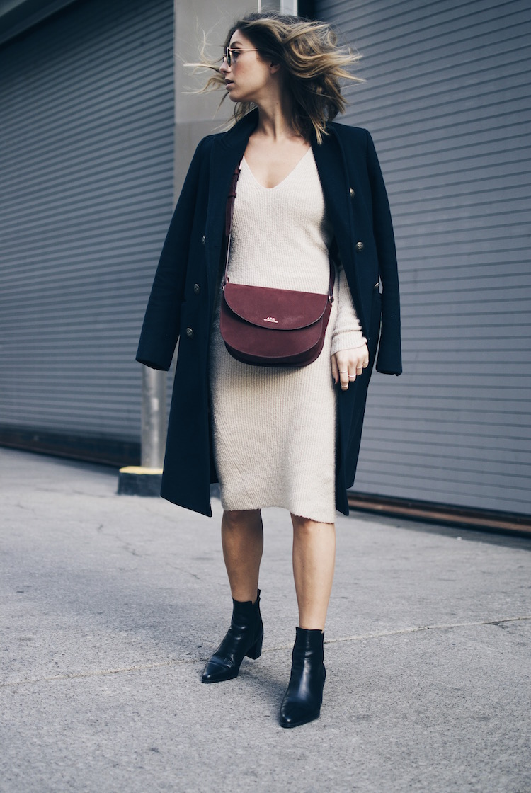 56969e3f611 Try wearing a sweater dress with ankle boots and an oversized coat this  fall. Via
