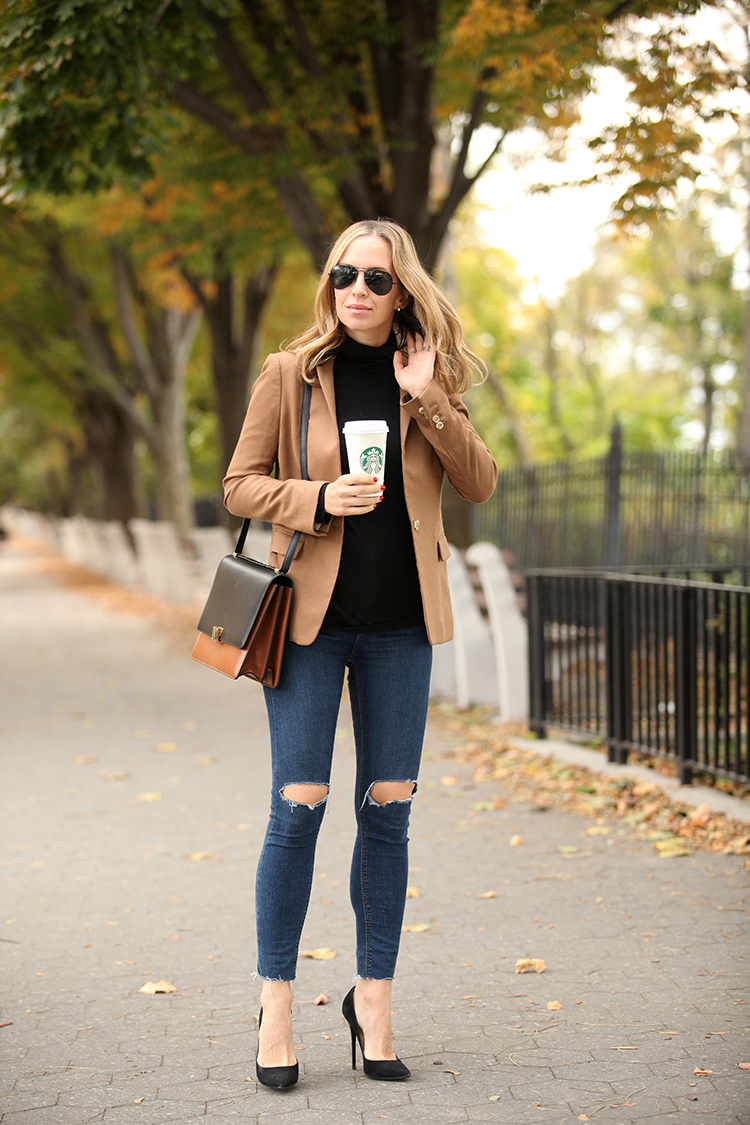 Helena Glazer wears a cute camel blazer over a black turtle neck, all paired with distressed denim jeans. Box Bag: Celine, Blazer: J Crew, Jeans: Topshop, Turtleneck: J Crew, Shoes: Jimmy Choo.
