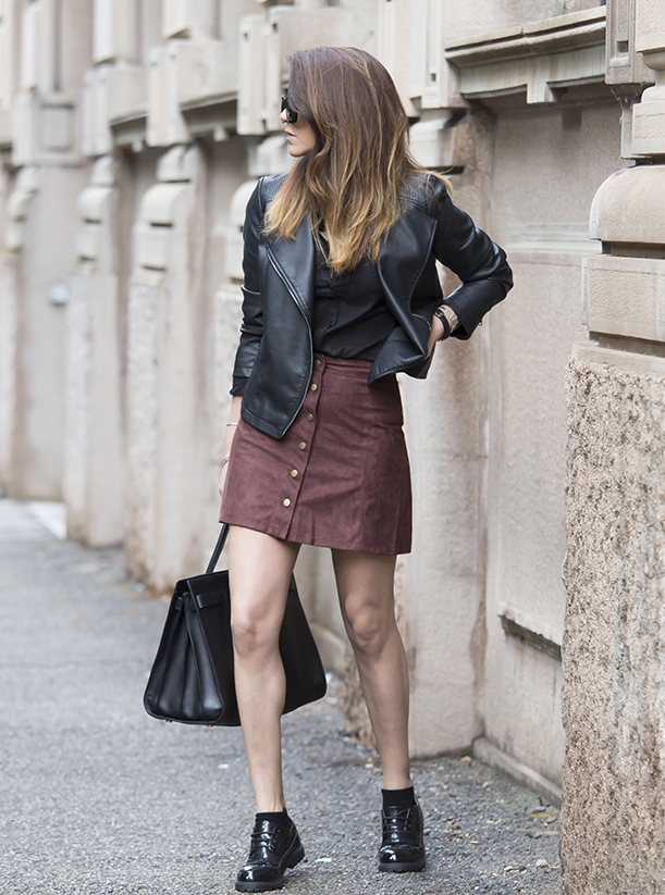 Nicoletta Reggio wears the button-front skirt trend with funky black brogues and a cute leather jacket.  Total Look: OVS.