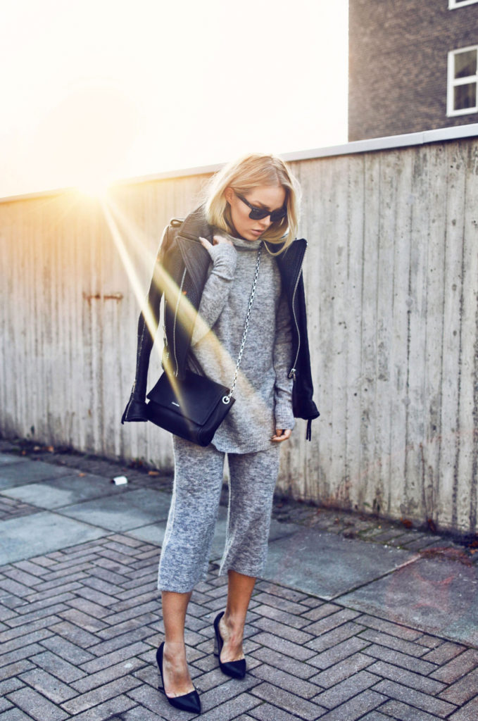 Angelica Blick shows us how to wear the two piece trend, pairing this grey number with a leather jacket and navy heels.   Two-piece: ASOS, Jacket: The Ixix.
