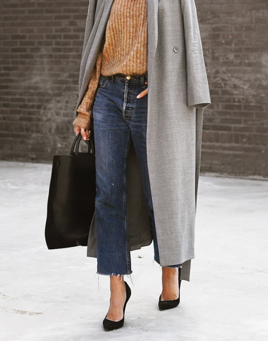 Joyce Croonen pairs a sophisticated black box bag with vintage jeans and a grey overcoat. Sweater: H&M, Jeans: Vintage Levi's, Heels: Diego Dolcini.