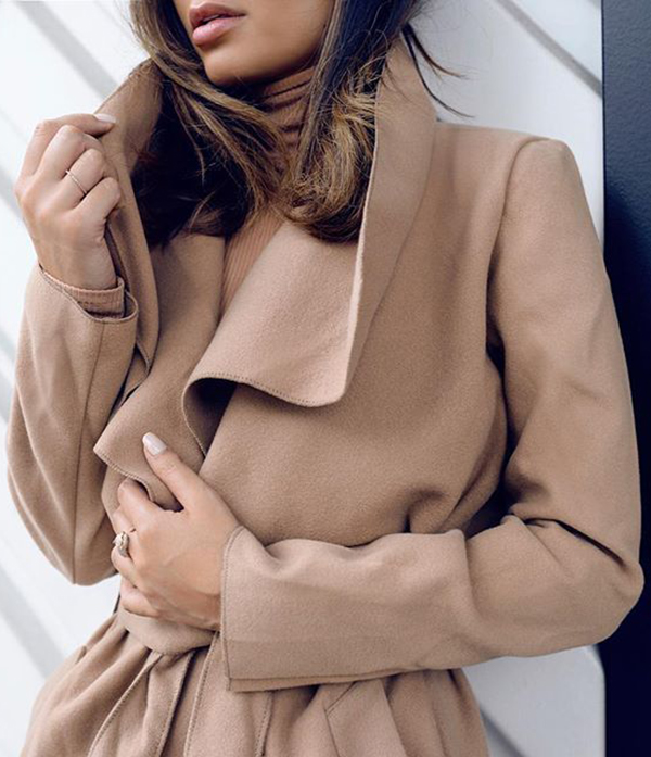 Marianna Elizabeth wears a matching tan turtle neck and coat.   Jacket: Missguided.