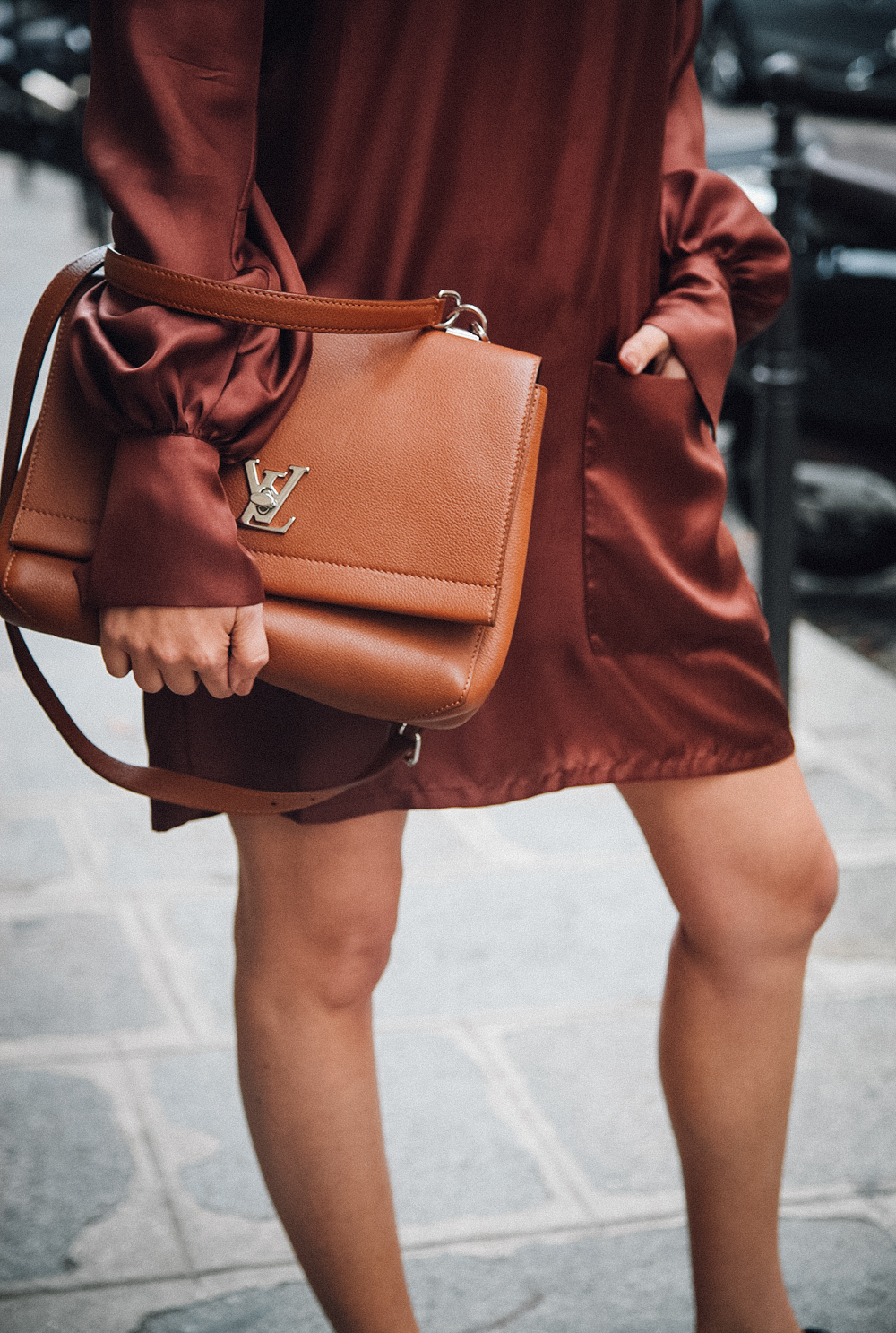 Rue Chateubriand accessorises her outfit with this gorgeous Louis Vuitton satchel. Dress: George Jensen, Bag: Louis Vuitton.