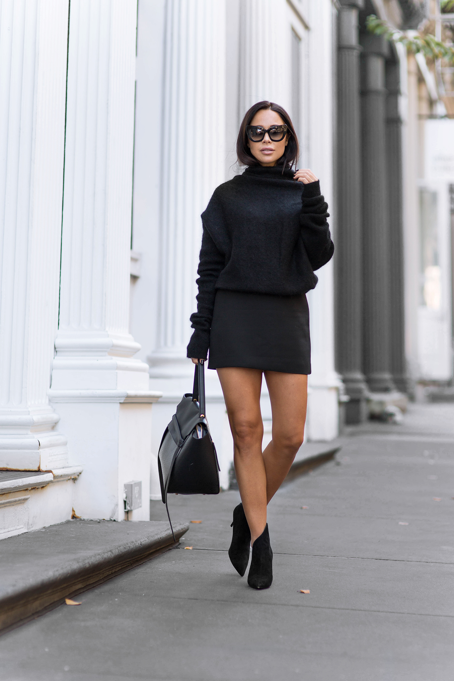 Johanna Olsson's cropped black extra long sleeved sweater looks cute worn with a black mini skirt and heels. Shoes: Giuseppe Zanotti, Sweater: Acne, Skirt: Zara, Sunglasses: The Valley, Bag: Celine.